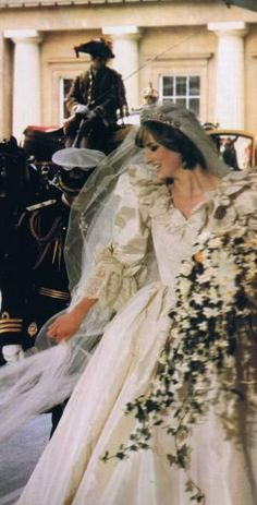 July 29, 1981: Lady Diana Spencer marries Prince Charles at St. Paul's Cathedral in London. Diana checks her veil as she enters Buckingham Palace on her wedding day.