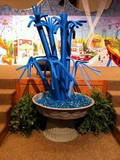 Neat fountain idea made from a plant pot, kiddie pool and pool noodles