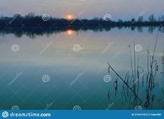 Photo about Natural gravel lake. Photographed at sunset. Slovakia. Image of blue, granite, natural - 214471813 Blue Granite, Sunset, Natural, Image, Art, Art Background, Kunst, Sunsets, Performing Arts