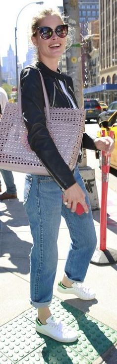 Who made Doutzen Kroes' white sneakers, pink cut out handbag, and blue jeans?