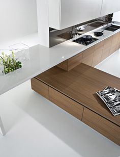 every home needs warmth and here the wood achieves this by breaking up the white of the walls, units and floors.