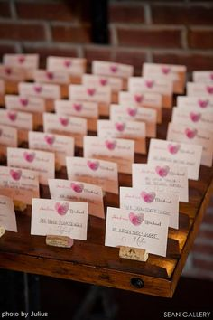 The bride and grooms thumbprints form a heart! Great #personalized #seatingcards.