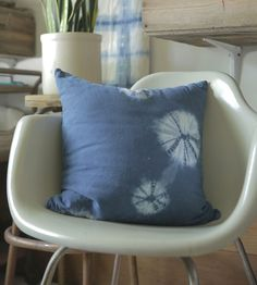 Deeply dyed and richly textured, this pillow shows the folds and creases from a shibori dyeing technique.