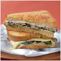 Mushroom, Spinach, and Smoked Gouda Sandwiches.  Why settle for a boring grilled cheese sandwich? Bite into the earthy flavors of mushrooms, spinach, and smoked Gouda.  TIP: Cook the sandwich on a panini press if you like.