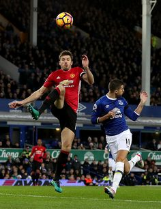 Manchester United's Michael Carrick and Everton's Kevin Mirallas battle for the ball during the Premier League match at Goodison Park Liverpool