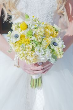 yellow wedding bouquet with anemones.. exactly what i'm looking for if we do have a gray and yellow wedding!!