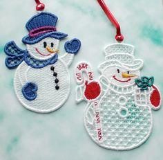 Embroidered snowmen decorations