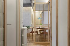 Concrete girders and glass partition walls carve up this broken-plan Bilbao apartment