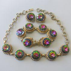 A watermelon rhinestone necklace bracelet and earrings set by Schiaparelli.