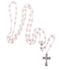 The pink heart Communion rosary is made of lovely pale pink European glass pearls shaped into tiny little hearts.