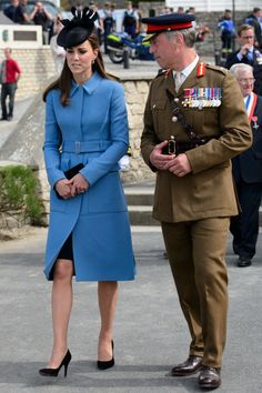 Princess Catherine, Duchess of Cambridge, speaks to a soldier in Arromanches-les-Bains, on June 6, 2014, during an event commemorating the 70th anniversary of the World War II Allied landings in Normandy. via StyleList