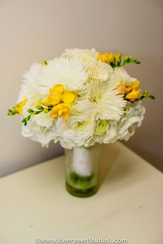 white and yellow bridal bouquet, gardenia, spider mums, freesia, ranunculus