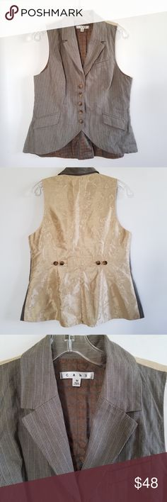 """NWOT CAbi Liverpool Waistcoat NWOT CAbi Liverpool Waistcoat. Size M. Adjustable back buttons. Dress up/down. Welt pockets. Approximate Measurements: 23"""" (Front) L; 24"""" (Back) L; 18"""" PTP. No rips, tears, stains. All Reasonable Offers Accepted. No Trades! Bundles: 20% OFF 2 or More! CAbi Jackets & Coats Vests"""