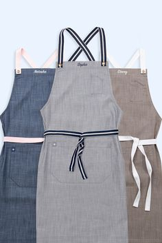 Our Henry Bib Aprons in Pebble, Mocha & Bluegrain now have the option to add Name Embroidery🙌   We can fit up to 10 letters per apron, and for just an extra $10 so its a brilliant gift idea for your team or a love one. The Henry Cross Back Apron also comes with your choice of colour strap making this the ultimate in apron personalisation 💕💙💛 | Personalised Apron | Cafe Apron | Kitchen Apron