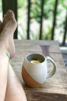 Sunday Vibes. Instead of my afternoon coffee I'm drinking an iced chai with fresh squeezed lemon. Sooo Good! I'm thinking about going t the beach, but honestly it's really hard to justify leaving my breezy, covered porch. My hubby made the beautiful table. I made the Handcrafted Stoneware mug. Availble on line at FernStreetPottery.com Ceramic Coffee Cups, Stoneware Mugs, Squeezed Lemon, Contemporary Classic, How To Squeeze Lemons, Pottery Mugs, Cream And Sugar, Pottery Studio, Natural Texture
