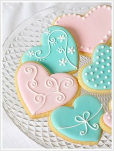 Pretty heart cookies. Really like the blue one with the flowers.