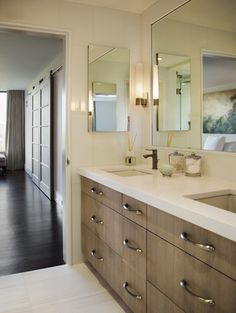 Bleached oak cabinets and high-gloss white tile give a clean, serene look