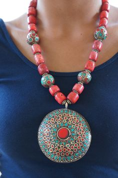 Handcrafted pendant made with the traditional lakh work and combined with red corals to add color and contrast