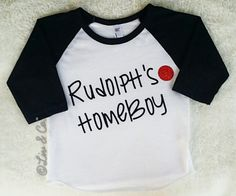 FREE SHIPPING IN THE USA! If you've been waiting for that perfect Christmas shirt for your little boy - look no further, you've found it!Rudolph's Homeboy™raglan baseball sleeve Christmastee is a Liv & Co.™ original design & slogan andwill be the staple shirt of your child's holiday wardrobe!!