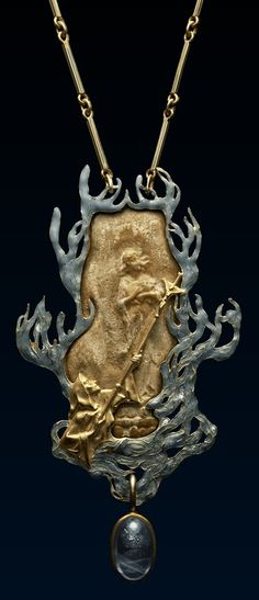 An Art Nouveau Joan of Arc Pendant, by René Lalique, circa 1900. Enamelled gold rectangular pendant enclosing a gold relief representing Joan of Arc burnt at the stake, with a man below holding up a crucifix, framed by flames to every side, sapphire hanging below. #Lalique #ArtNouveau #pendant