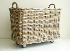 Rolling Rattan Basket. Store anything from blankets to sporting equipment in one convenient and mobile spot.