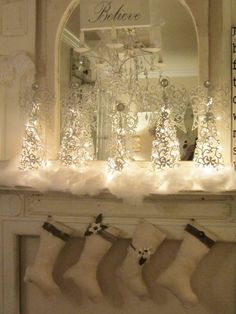 Christmas mantel (from Junk Chic Cottage)  love the idea of a mirror behind to pick up and enhance the glow