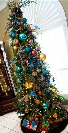 Leopard and turquoise Christmas decor Narrow Christmas Tree, Peacock Christmas Tree, Pencil Christmas Tree, Turquoise Christmas, Beautiful Christmas Trees, Colorful Christmas Tree, Trees Beautiful, Indoor Christmas Decorations, Christmas Tree Themes