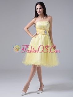 2013 Light Yellow Sweet Prom Cocktial Dress With Beaded Decorate and Ruch Strapless Organza  http://www.fashionos.com  Be a sweet princess at your 2013 proms. This elegant evening gown featuring a strapless neckline bodice with delicate ruching and shinning beading that give you a wonderful look. The waistband is decorated with a beaded brooch, highlighting the whole look of the dress. The a-line skirt is made of layers of organza and flatters mose figures.