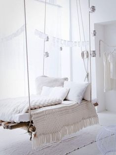 Hanging bed with rustic log base, Remodelista