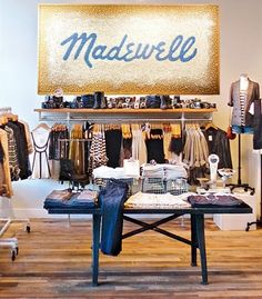"Affectionately nicknamed ""J. Crew's little sister,"" Madewell masters cool downtown style. I love their on-trend pieces, like striped dresses, silk blouses, and the perfect red wool hat. La Petite Boutique, A Boutique, Clothing Displays, Hotel Restaurant, Retail Store Design, Retail Stores, Retail Merchandising, Store Fixtures, Store Displays"