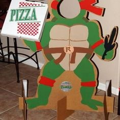 ninja turtle cardboard cutout for birthday decor :) OR make a pin the mask/pizza on the TMNT