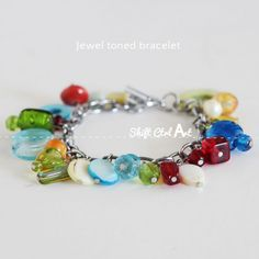 Shell Necklace Reference: Jewel toned bracelet Dare to give hand made. She has one bead per link.