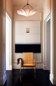 Entry vestibule featuring artwork from Dolby Chadwick Gallery and Coquille Pendant by Remains