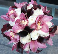 this was my wedding bouquet. burgundy orchids, black cala lilies, and white roses.