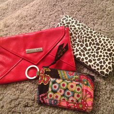 Vera Bradley ID Holder + 2 bags 3 bags bundled. 1. Small key-ringed Vera Bradley ID holder. Older print in used condition with no noticeable flaws. 2. Red Mary Kay magnetic clutch. Never used. 3. Spotted wallet, new with tags. Make me an offer! Vera Bradley Bags Clutches & Wristlets