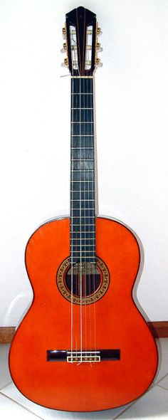 Yamaha 6-string classical acoustic guitar.