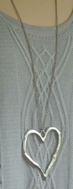 Lovely open heart on a long chain