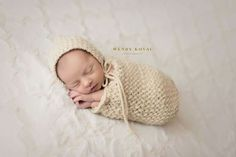 Knitted newborn swaddled sack and bonnet