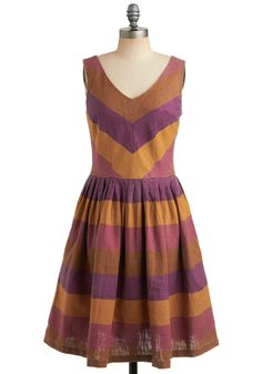 Knitted Dove linen dress with darted V-neckline, side pockets and full, pleated skirt. Wide stripes print of faded pumpkin, plum, grape and ochre