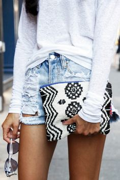 White sweater, shorts, cute bag, and sunglasses
