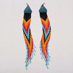 I'm not all that crazy about the top part of the design, but the DANGLES are breath taking!!! Native American Extra Long Style Chevron Beaded Earrings. $100.00, via Etsy.