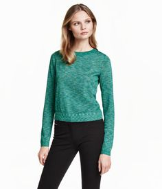 Airy, fine-knit sweater with glittery threads. Long sleeves and slightly wider ribbing at neckline.