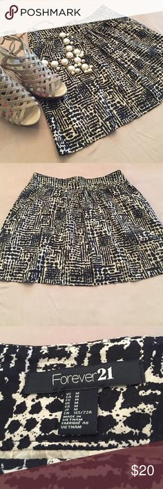 F21 patterned skirt Almost animal-like print. So adorable! Can be worn classically with a blazer or add a pop of color! Very cute piece  hidden pockets and zipper closure Forever 21 Skirts
