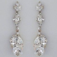 Erin Cole Crystal Bridal Chandelier Earrings. Stunning crystal teardrop bridal earrings for weddings, evening wear & black tie affairs.