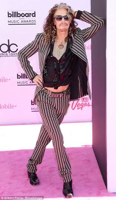 Loving his look: Steven Tyler showed off some awesome poses as he made his entrance