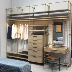 The Collector's 4 Bay Wardrobe Unit shown in Silvered Oak and Warm Brass. This dream closet is something that doesn't need to be hidden!