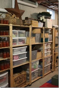 Organization for the basement. I love the idea of building plain, strong, utility shelves to hold Rubbermaid tubs. [ This totally looks like it could be my room, lol.]