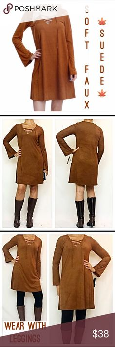 "Soft Faux Suede Lace Up Tunic Dress Small This Gorgeous rich brown butter soft faux suede tunic dress can be worn alone or with leggings-so versatile. The lace up front adds some flare to this boho beauty. Easy to wear flowy, flattering fit-92% polyester/8% spandex (lightweight & provides nice stretch). S M Measurements laying flat: Small Bust 32-34 Length 34"" Waist 17""  Model is wearing small for reference slip Dresses"