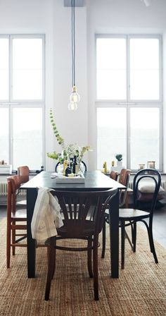 This collection of interior spaces from blogger Celine, of Frenchy Fancy, is full of design inspiration that you can use in your home. This modern dining room uses bright white walls and a blank canvas for eclectic furniture and earthy textures to bring this look together.