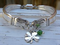 Spoon handle bracelet - clover charm - green crystal bead - you choose color  - silver plated ornate vintage spoons - magnetic screw clasp by WhisperingMetalworks on Etsy https://www.etsy.com/listing/224691681/spoon-handle-bracelet-clover-charm-green